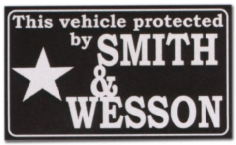 Hinweisschild - This vehicle protectet by SMITH WESSON - LKW Trucker Brummi Schild Warnschild